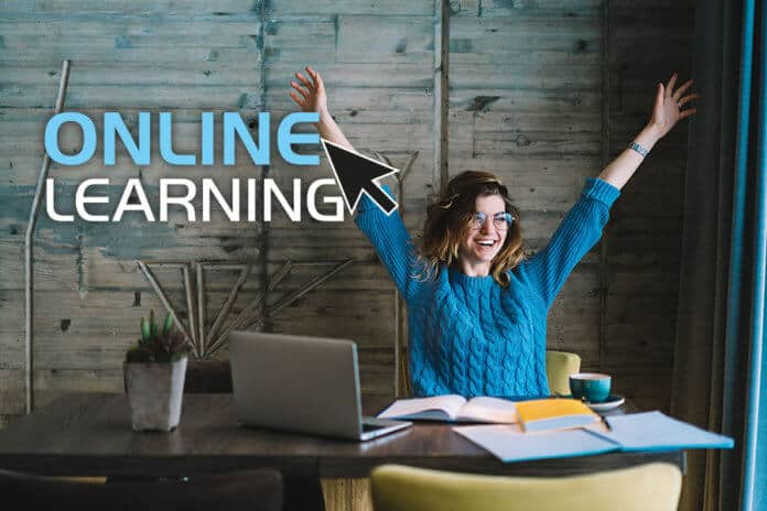 Happy girl taking online course