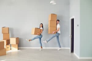 Couple funnily perform with cardboard boxes