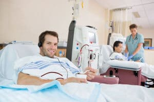 Patient listening music during dialysis