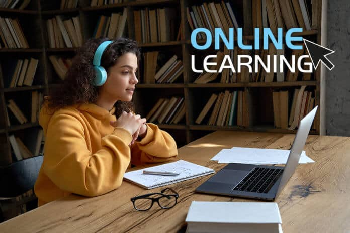 A girl in a library doing an online course
