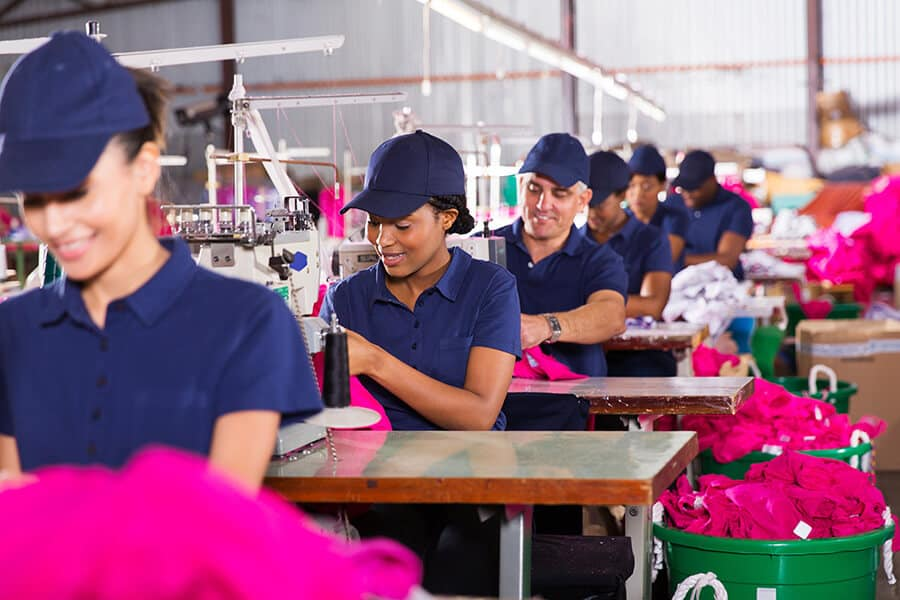Factory workers working in clothing factory