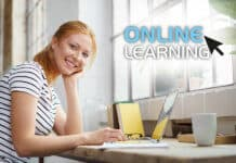 Smiling young woman studying at home an online course
