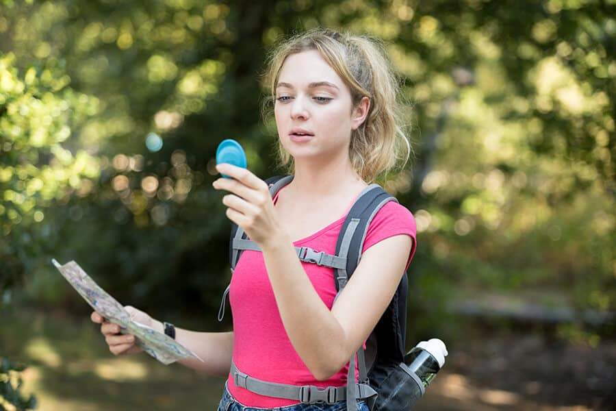 Woman using a compass outdoors