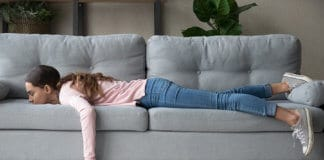 Bored woman lying on a couch