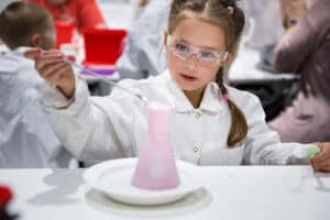 A little girl working on chemical experiment