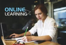 Concentrated woman studying an online course