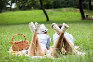 Couple enjoying relaxing picnic time in a park