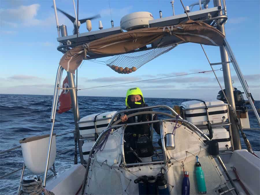 Dr. Emily Duncan on the boat during the expedition on the North Pacific