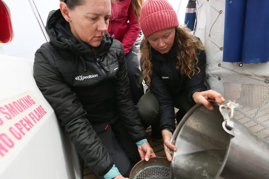 Dr. Emily Duncan and her team collecting samples from the ocean