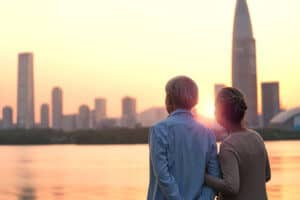 Senior couple looking at sunset and city skyline of Singapore