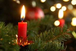 Burning candle on Christmas tree