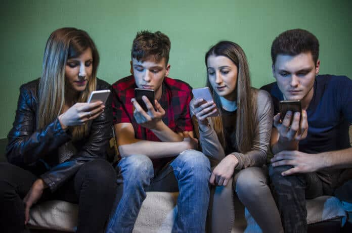 Group of teenagers communicating on social media