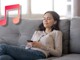 Girl wearing earphones listening to iTunes