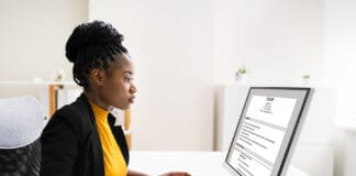 Woman writing her cover letter