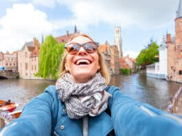 Young happy student in Bruges, Belgium